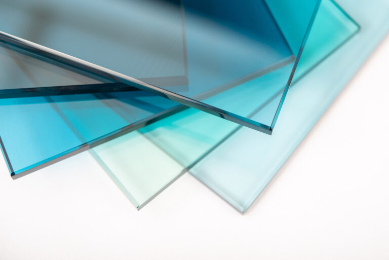 a stack of different types of glass in varying shades of blues
